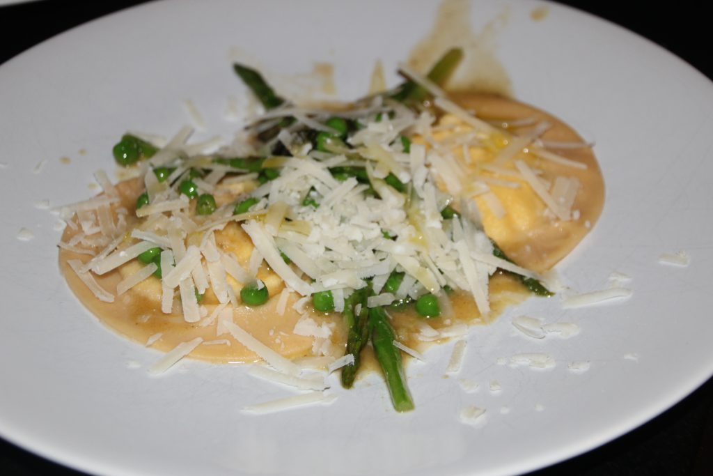 Ravioli Served in a Sage Butter Sauce with Spring Veg